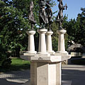 """Four Seasons"", a group of bronze statues on stone pedestal in the park - Tapolca, Maďarsko"