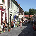 Cobbled medieval street with contemporary cafés and shops - Eger, Macaristan