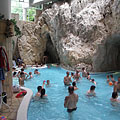 The indoor bath hall of the Cave Bath in Miskolctapolca, including the thermal water adventure pool and the entrances of the cave pools - Miskolc, Macaristan