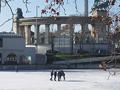 "A group of children on the City Park Ice Rink (""Városligeti Műjégpálya""), with the Millenium Memorial - Budapest, Hongrie"