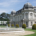 The north wing of the Festetics Palace, there is a fountain in the park in front of it - Keszthely, Węgry