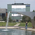 Modern style artificial waterfall at the small pond surrounded by office buildings - Будапеща, Унгария