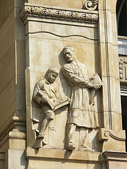 """A relief called """"Education"""" on the wall of the Hungarian National Bank building - Budapest, Ungarn"""