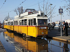 In spite of how it looks, this yellow tram No.19 (Ganz UV model) cannot run on the water, just the station of it has flooded - Budapest, Ungarn
