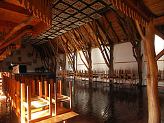 """The grand hall of the Village Community Center (""""Faluház""""), and special Szekely patterns on its ceiling - Kakasd, Ungarn"""