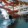 The three-story Mediterranean atmosphere atrium of the waterpark with an extremely long indoor giant water slide - Kehidakustány, Ungarn
