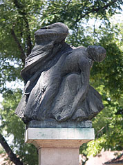 Bronze pieta statue on the memorial monument of the World War II and the Hungarian Revolution of 1956 - Nagykőrös, Ungari