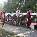 "Here comes the loud ""Lanky Garaboncids"" (""Langaléta garabonciások"") on stilts - Szentendre, هنغاريا"