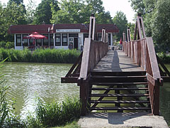 The footbridge and the Tó Restaurant, viewed from the small island - Ajka, Hungary