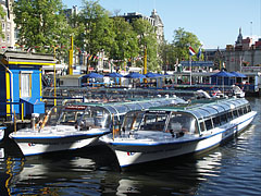 Sightseeing boats in the harbour - Amsterdam, Netherlands