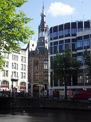The tower of the Magna Plaza Shopping Centre, viewed from the Singel gracht (canal) - Amsterdam, Netherlands