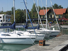 "Yacht marina with the yellow building of the reputable ""Vitorlás"" restaurant - Balatonfüred, Hungary"
