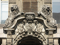 Stone lions over the entrance of the Csáky-Cziráky Palace apartment building - Budapest, Hungary