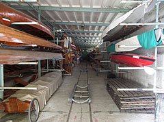 "Kayaks, canoes and rowing boats in the ""Hattyú"" boathouse - Budapest, Hungary"