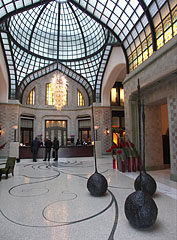 Atrium with glass roof and contemporary sculptures - Budapest, Hungary