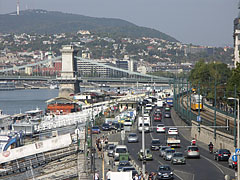 The car traffic of the lower embankment in Pest, berths by the Danube River, as well as the Chain Bridge and the Hármashatár Hill on the same picture - Budapest, Hungary