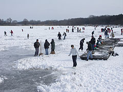 Lake Naplás in winter, with skaters on its ice surface - Budapest, Hungary