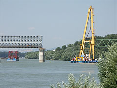 "The Újpest Railway Bridge is undergoing reconstruction, the Clark Ádám (""Adam Clark"") floating crane is just inserting a new green bridge element to its place - Budapest, Hungary"
