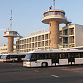 The Terminal 1 of the Budapest Ferihegy Airport (from 2011 onwards Budapest Ferenc Liszt International Airport) with airport buses in front of the building - Budapest, Hungary