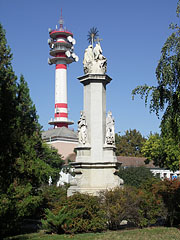 Baroque Holy Trinity Column, and in the distance it is the TV tower - Cegléd, Hungary