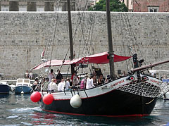Sailing boat with tourists in the old City Harbour - Dubrovnik, Croatia