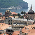 The cathedral of Dubrovnik is dedicated to Virgin Mary, and in the distance it is Lokrum Island - Dubrovnik, Croatia