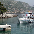 An excursion boat arrives to the island - Dubrovnik, Croatia