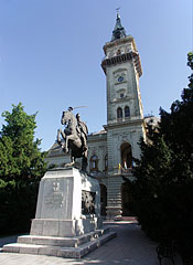 The tower of the City Hall, as well as the World War I memorial with the hussar horseman statue in front of it - Hódmezővásárhely, Hungary