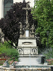 Baroque Calvary sculpture group in the main square, and the fountain with the frogs in front of it - Jászberény, Hungary