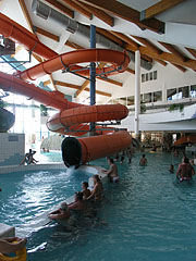 The three-story Mediterranean atmosphere atrium of the waterpark with an extremely long indoor giant water slide - Kehidakustány, Hungary