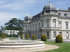The north wing of the Festetics Palace, there is a fountain in the park in front of it - Keszthely, Hungary