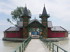 The wooden changing room pavilion of the Keszthely Beach on the small island - Keszthely, Hungary