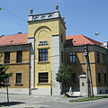 The brown and yellow building of the District Court (Town Court) with the characteristic square tower - Kiskunfélegyháza, Hungary