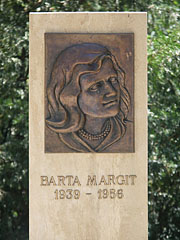 Bronze plaque in memory of Margit Barta, the 17 years old schoolgirl was one of the innocent victims of the Hungarian Revolution of 1956 - Nagykőrös, Hungary