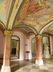 The Tardos red marble pillars and the gorgeous frescoes on the ceiling in the Main Library Hall - Pécel, Hungary