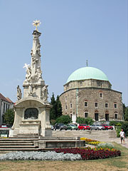 The Holy Trinity statue and the mosque behind it - Pécs, Hungary