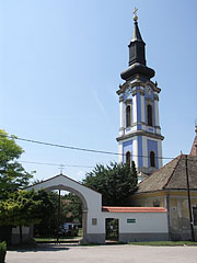 "Wall and gate of the so-called ""Serbian Croft"" or ""Serbian Yard"" (in Hungarian ""Szerb Porta""), and the blue tower of the Serbian Orthodox Church and Monastery - Ráckeve, Hungary"