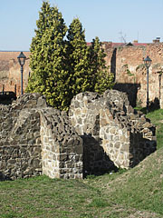 The wall remains of the medieval church, and the castle walls behind it - Szécsény, Hungary