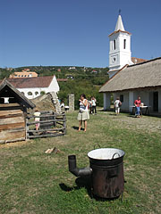 Yard of the croft from Nyirád, with the with tower of the church from Óbudavár in the distance - Szentendre, Hungary
