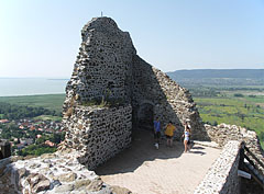 Shady wall remains of a premise, with Lake Balaton in the distance - Szigliget, Hungary