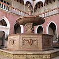 The renaissance inner courtyard of the palace, including the red marble Hercules Fountain - Visegrád, Hungary